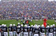West Virginia blown out in bowl game/Penn State dismisses two players